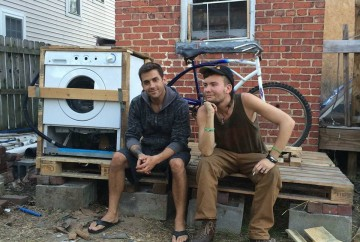Emmett and Dustin pose by their newly completed bicycle powered wash machine